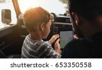 rear view shot of father and... | Shutterstock . vector #653350558