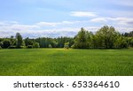 green field and blue sky.... | Shutterstock . vector #653364610