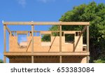 A Two Story Wooden House Under...