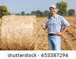 Young Farmer In A Meadow