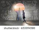 businessman walking towards... | Shutterstock . vector #653394580