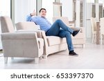 young man shopping in furniture ... | Shutterstock . vector #653397370