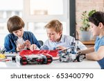 concentrated young technician... | Shutterstock . vector #653400790