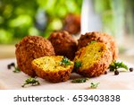 fresh falafel balls on a wooden ... | Shutterstock . vector #653403838