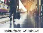 man is having a backpack behind ... | Shutterstock . vector #653404369