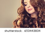 brunette  girl with long  and   ... | Shutterstock . vector #653443834