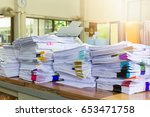 pile of unfinished documents on ... | Shutterstock . vector #653471758
