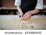 unrecognizable cook making... | Shutterstock . vector #653484430