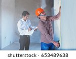 architect and engineer inspect... | Shutterstock . vector #653489638