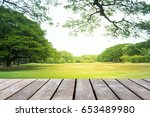 empty wooden table over park... | Shutterstock . vector #653489980