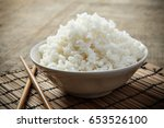 a bowl of rice on a bamboo mat | Shutterstock . vector #653526100