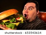 diet failure of fat man eat... | Shutterstock . vector #653543614