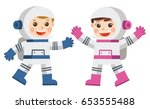 astronaut boy and girl in space ... | Shutterstock .eps vector #653555488