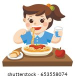 a little girl happy to eat... | Shutterstock .eps vector #653558074
