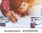 hands of architect holding... | Shutterstock . vector #653583028