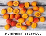 Crowd of ripe apricots on white ...