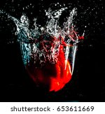 Red Pepper Splashing To Water