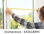 young man installing window... | Shutterstock . vector #653618890
