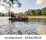 Small photo of PAHANG, MALAYSIA - MARCH 18, 2017 : Bundles of people enjoying airboat ride with nice lake scene.