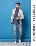happy handsome man over blue... | Shutterstock . vector #653625118