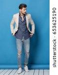happy handsome man over blue... | Shutterstock . vector #653625190