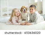 happy children with dog | Shutterstock . vector #653636020