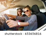 two attractive friendly young... | Shutterstock . vector #653656816
