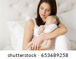 view at young mother and cute...   Shutterstock . vector #653689258