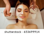 on face of  woman beautician... | Shutterstock . vector #653699914