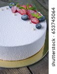 Small photo of White velour cake with fresh berries