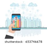 smartphone in hand helps to... | Shutterstock .eps vector #653746678