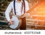 view of musician playing banjo...