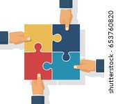 hands holding puzzle. pieces... | Shutterstock .eps vector #653760820