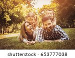 happy family enjoying together... | Shutterstock . vector #653777038