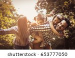 happy family enjoying together ... | Shutterstock . vector #653777050