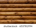 wooden wall from logs of pine...
