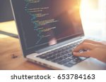 closeup coding on screen  woman ... | Shutterstock . vector #653784163