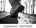 legs of a man walking in a park ... | Shutterstock . vector #653791834