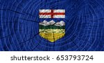 alberta flag on wood texture... | Shutterstock . vector #653793724