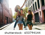 outdoor shot of young woman... | Shutterstock . vector #653794144