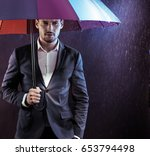 handsome businessman under an... | Shutterstock . vector #653794498