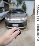 Small photo of selective focus of hand press the remote control car alarm system