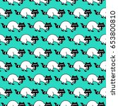 seamless pattern with raccoon.... | Shutterstock .eps vector #653800810