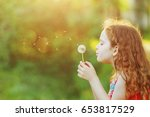 beautiful little girl enjoying... | Shutterstock . vector #653817529