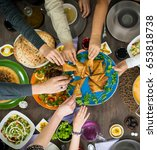 table of enjoying food with... | Shutterstock . vector #653818738