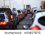 the flow of cars that drive in... | Shutterstock . vector #653827870
