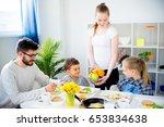 family having breakfast   Shutterstock . vector #653834638