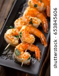spicy shrimp skewers served on... | Shutterstock . vector #653845606