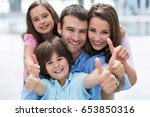 young family smiling  | Shutterstock . vector #653850316