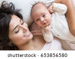 young mother with her baby in... | Shutterstock . vector #653856580